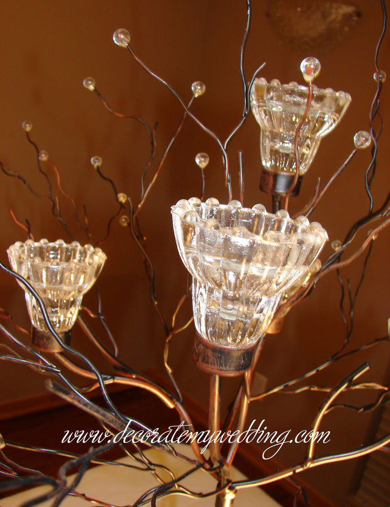 A close up look at the crystal candle cups and beaded tips on the metal branches.