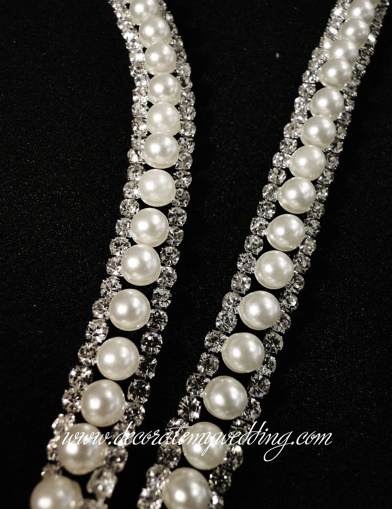 A close up look at the pearl and rhinestone trim.