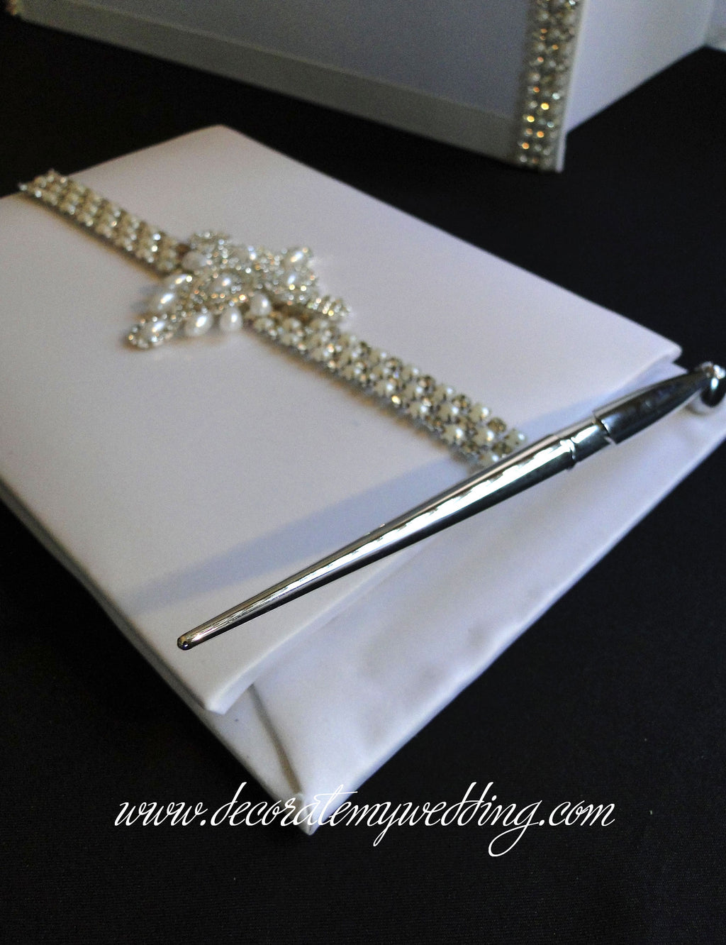 A pearl and rhinestone accented wedding guest book.