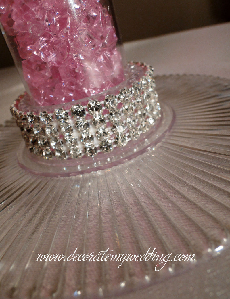 A close up look at the rhinestone banding trim on the base of the reception centerpiece.