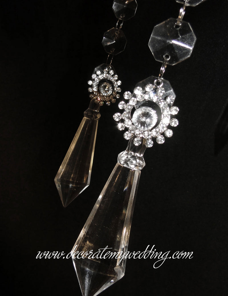 A close up look at the large diamond pendant.