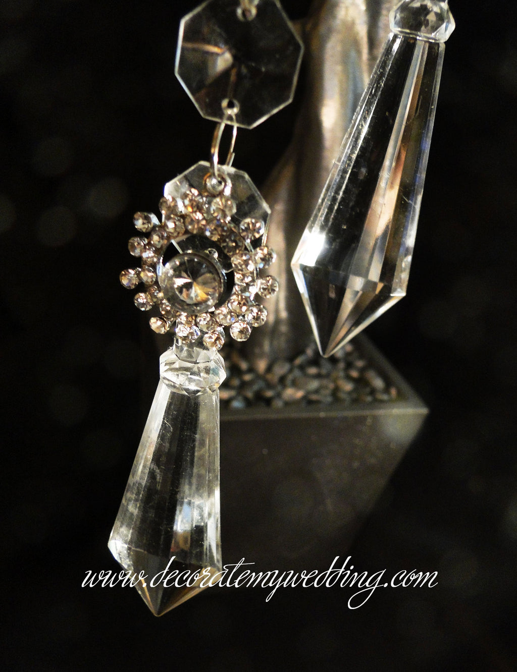 The diamond pendant strands has large diamond pendant attached to a string of octagon beads and a rhinestone embellishment.