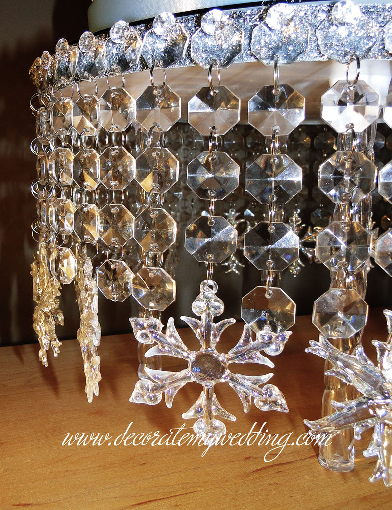 A close up look at the glass octagon bead strands and crystal snowflakes.