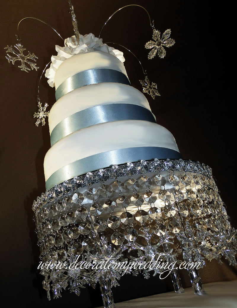 This snowflake cake decoration is a perfect stand for any winter wonderland wedding theme.