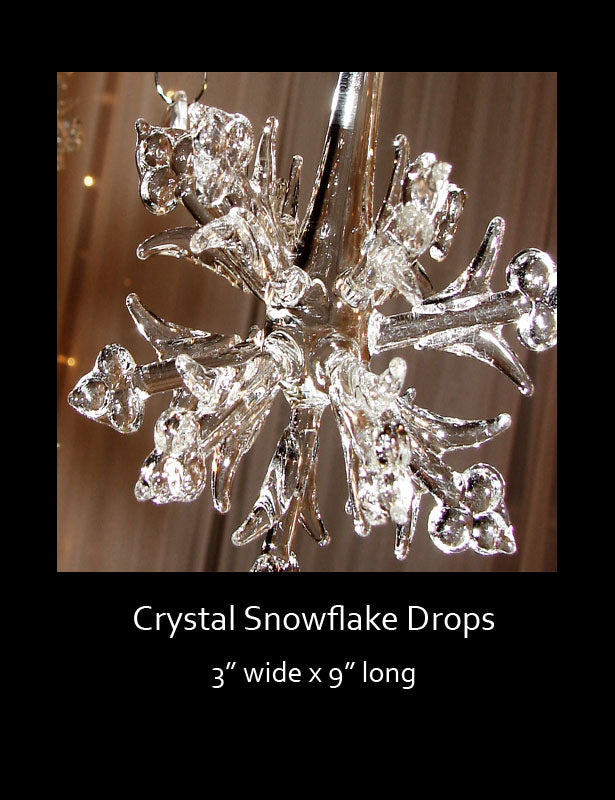 This 3-D snowflake ornament has an explosion of snowflake shapes at the end of a glass tube-like stem.