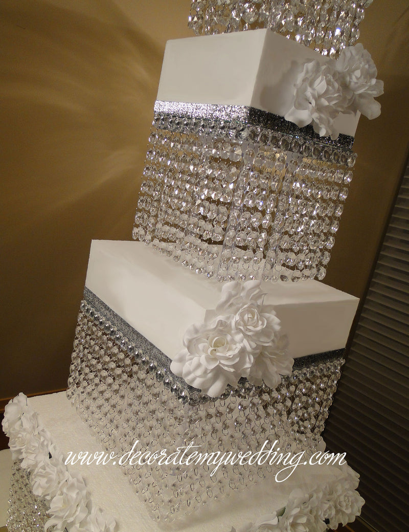This stunning square cake stand displays hundreds of hanging crystal beads that will shimmer at the slightest source of light.
