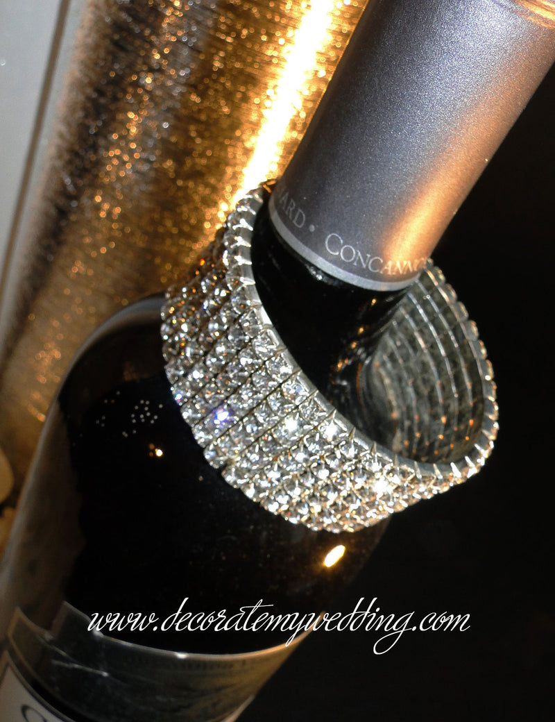 This stretchy rhinestone bracelet is a one size fits all, and is available in silver or gold.