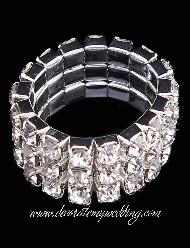 This stretchy ring has three rows of clear, glass rhinestones, and one size fits all.