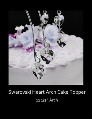 The Swarovski cake topper has an arched-shape with crystal hearts that dangle from each of the arch supports.