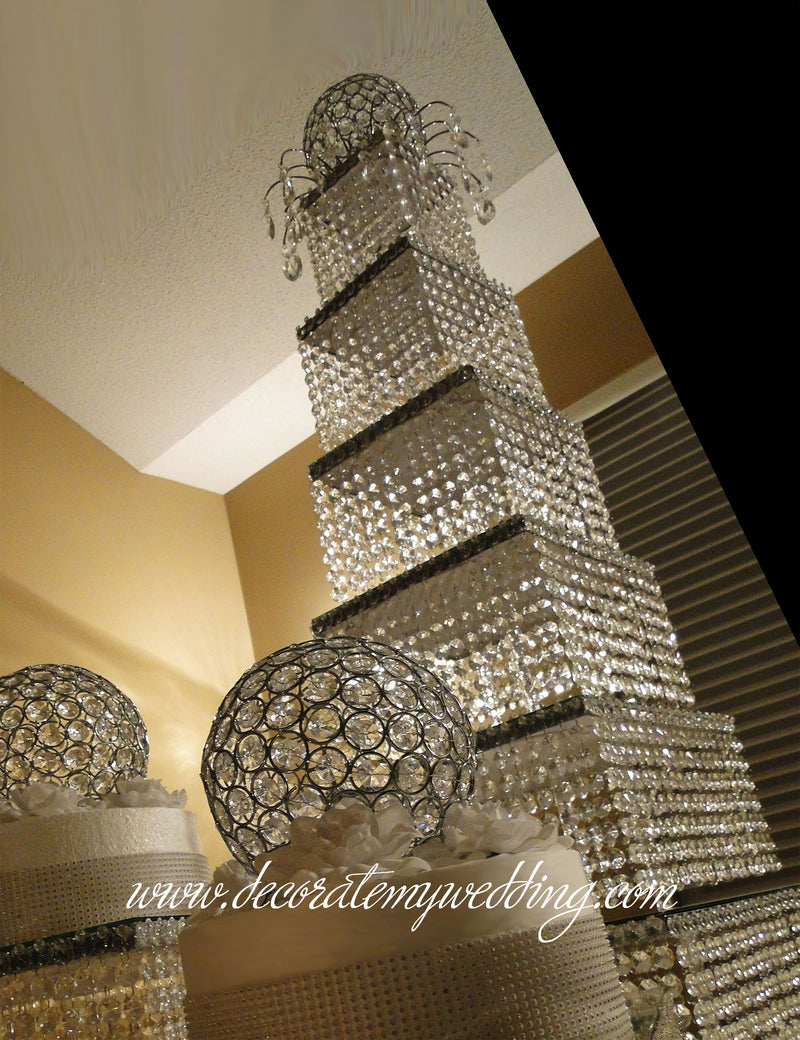 Stack them to the ceiling! Many crystal tiers of crystals create this very tall wedding centerpiece.