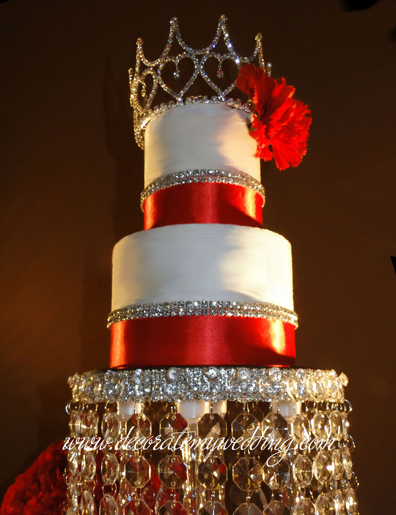 Full view of tiara cake crown on a wedding cake.