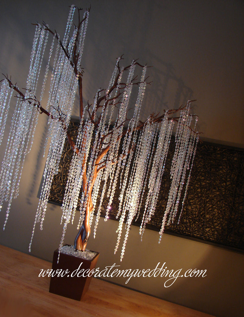 Brown tree kit includes a fake tree,  iridescent bead strands, and hooks  and spotlights.