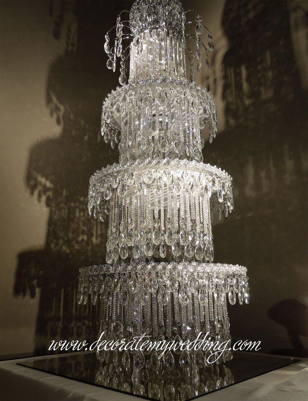 The multiple tiers of stacking crystals creates this sensational and unique wedding centerpiece.