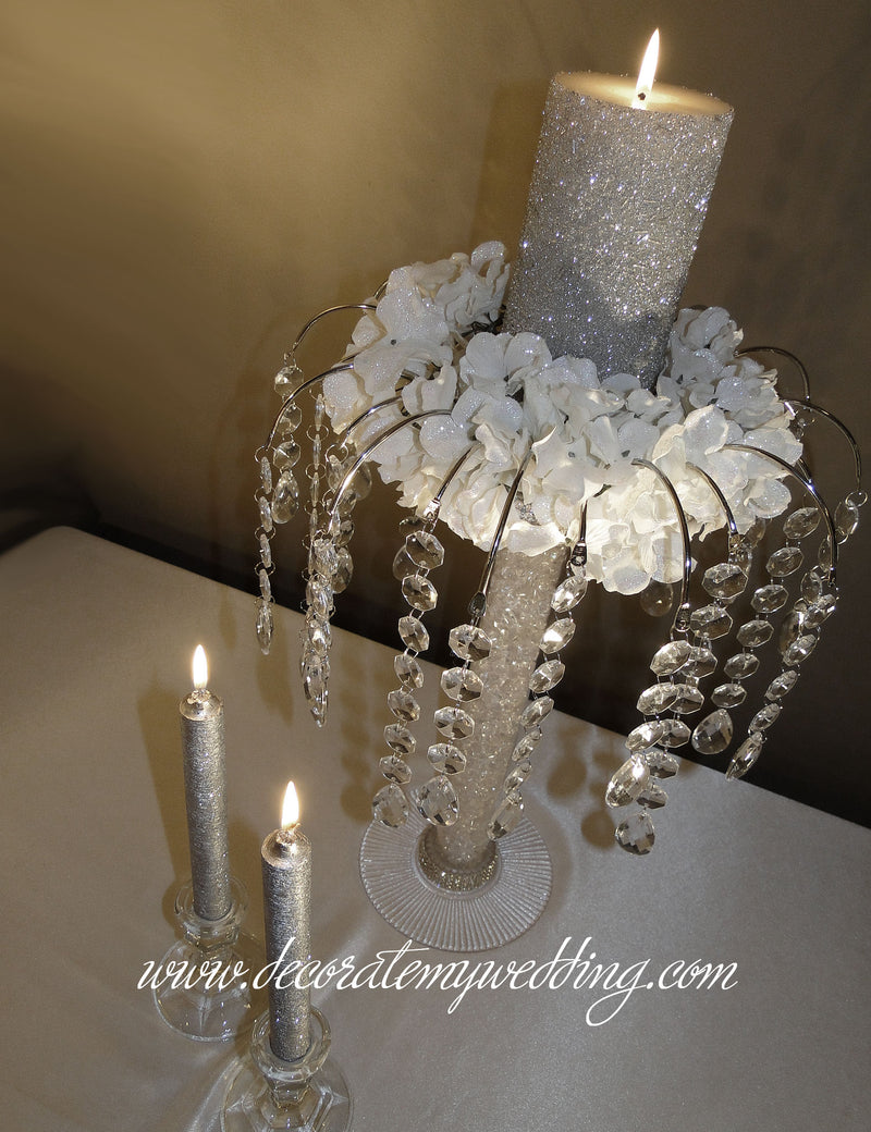 Unique unity candle with handing crystal beads, white gardenia blooms, and the tube is filled with acrylic pebbles.