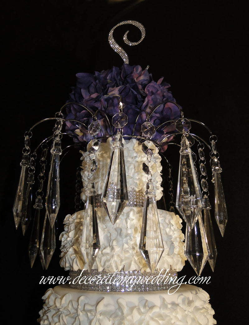 A close up look at the acrylic diamond pendants that hang from the wedding cake topper What you will receive.