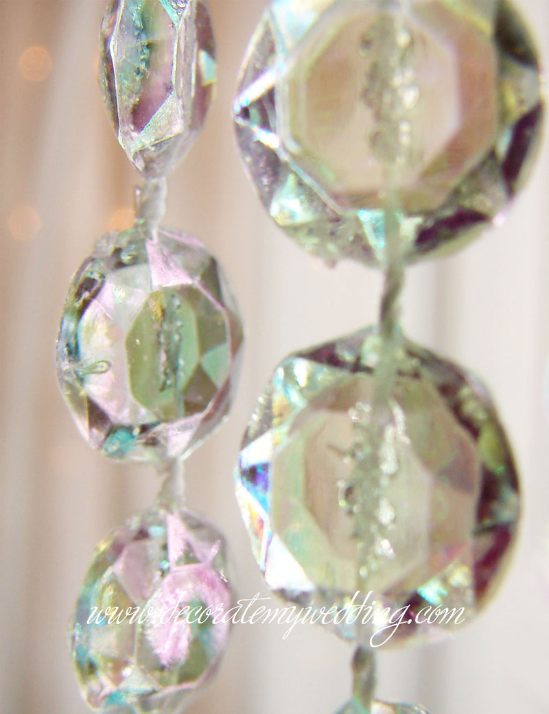 A close look at the iridescent bead strands used to create the wedding decoration.