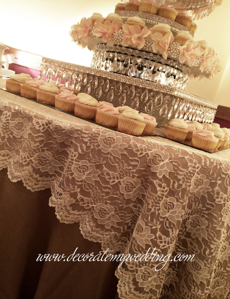 If you have more cupcakes than what the stand will hold, you can creatively display them on the table below the cupcake stand.