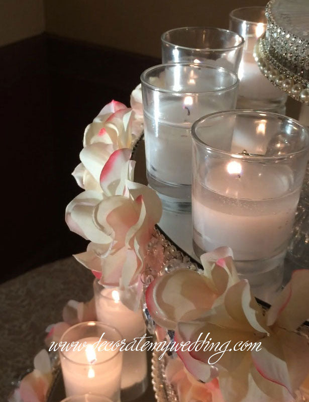 After the wedding this cupcake display can be converted to a large candle centerpiece.
