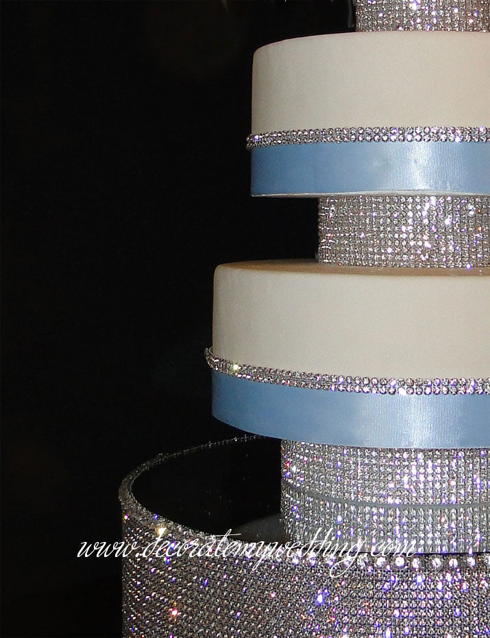 A close up look shows how the cake layers extend over the risers.