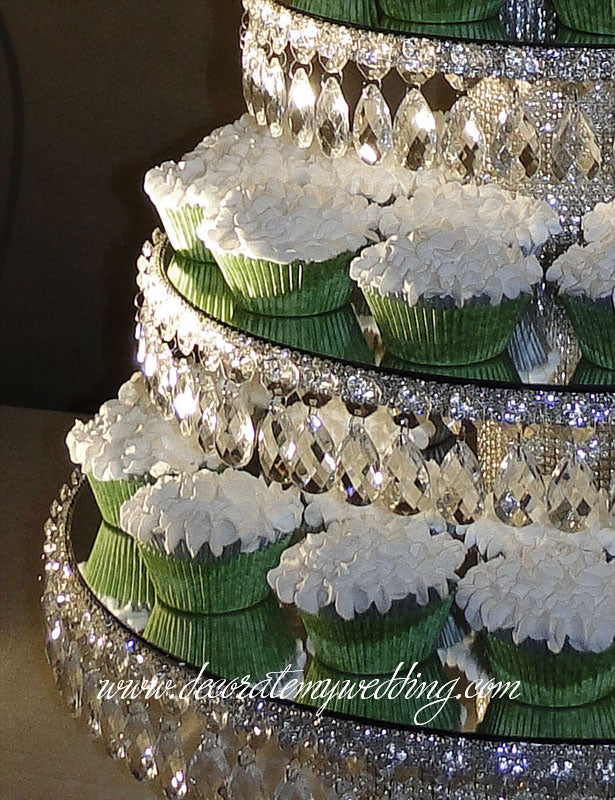 A close up look at the arrangement of cupcakes on each crystal tier.