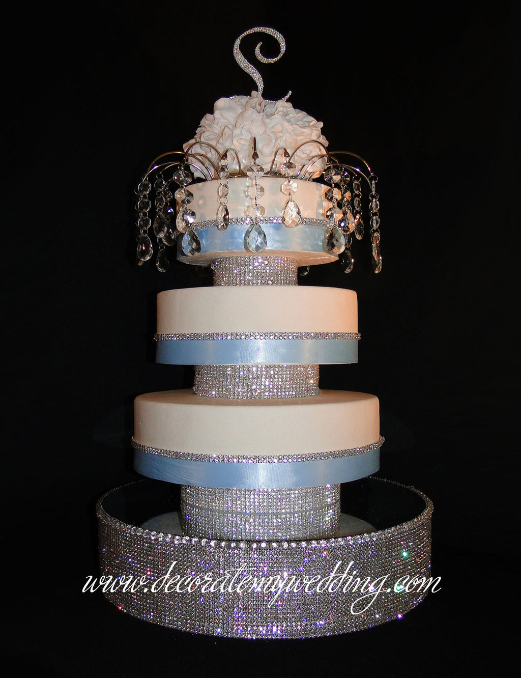 The wedding cake risers are completely covered with Swarovski rhinestones. The cake platform pictured is sold separately.