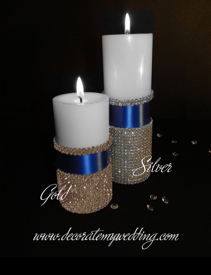 Pillar candle wrapped in rhinestone banding and royal ribbon.