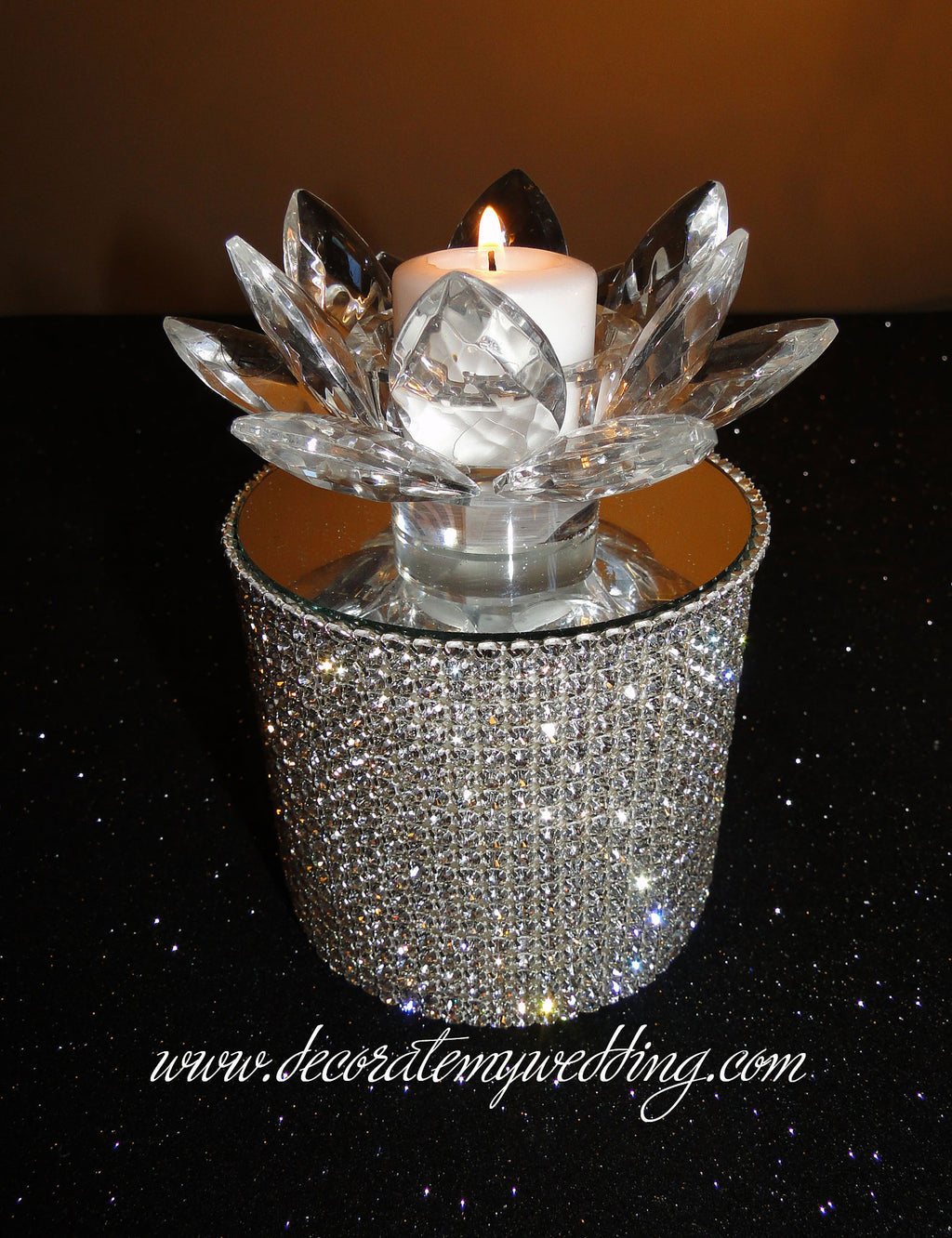 This silver rhinestone riser used for wedding candles is completely covered with silver rhinestones and topped with a beautiful beveled mirror.