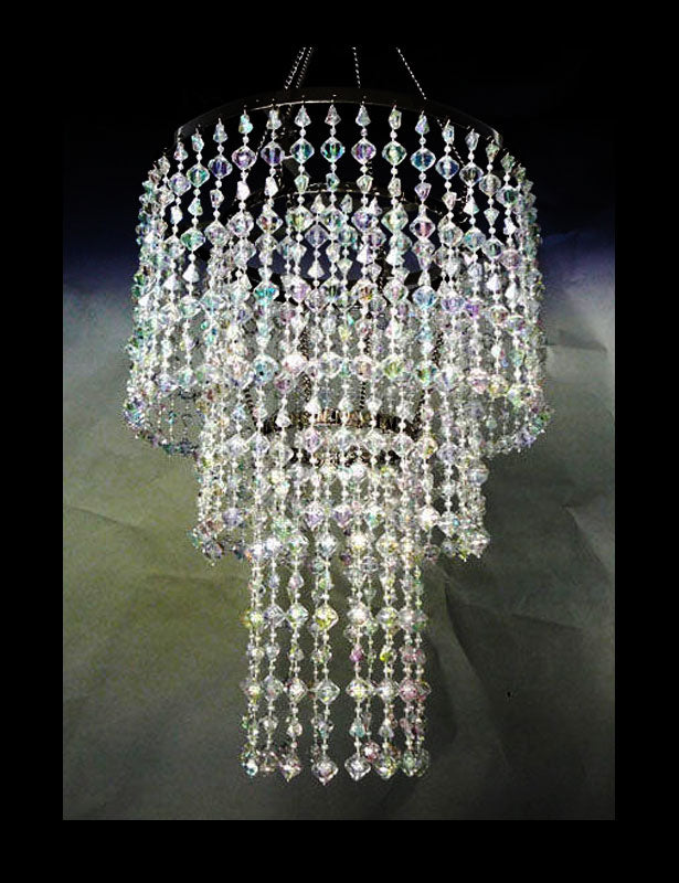 This 3-tier wedding chandelier is made with iridescent beads and includes a light kit for illumination.