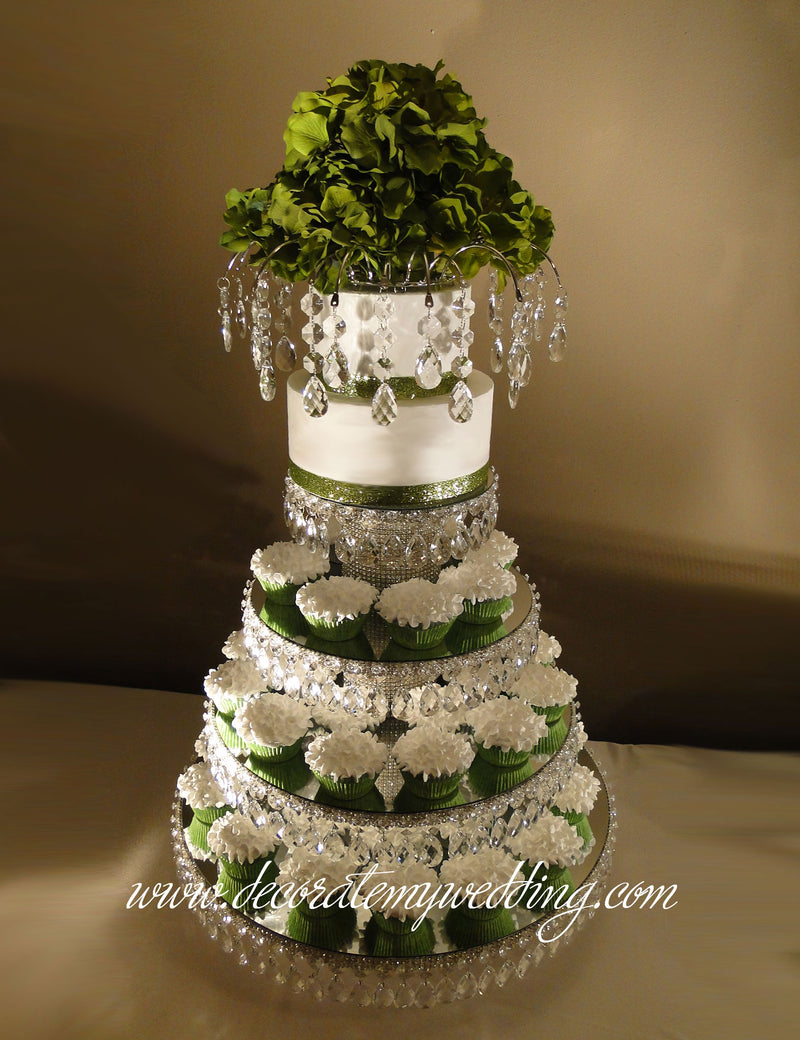 This four-tier wedding cupcake stand is completely covered with Swarovski rhinestones and dangling teardrop beads.