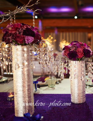 These beautiful wedding flower centerpieces are made with a vase, our graceful arch décor, and a bridal flower bouquet.