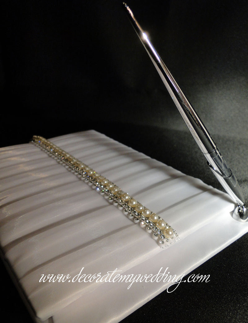 Wedding guest book trimmed with pearls and rhinestones.