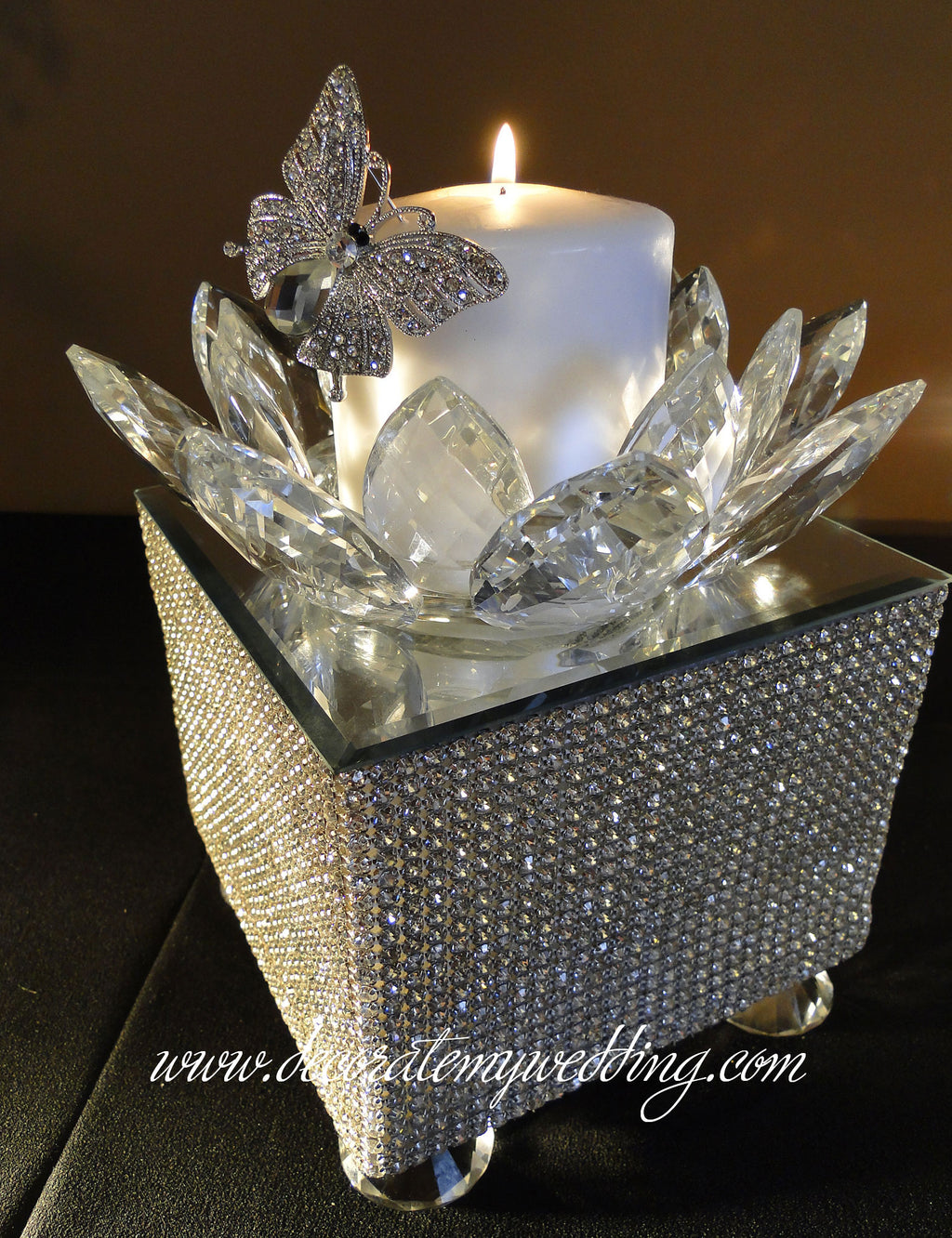 The square format of this wedding reception centerpiece is completely covered with Swarovski rhinestones.