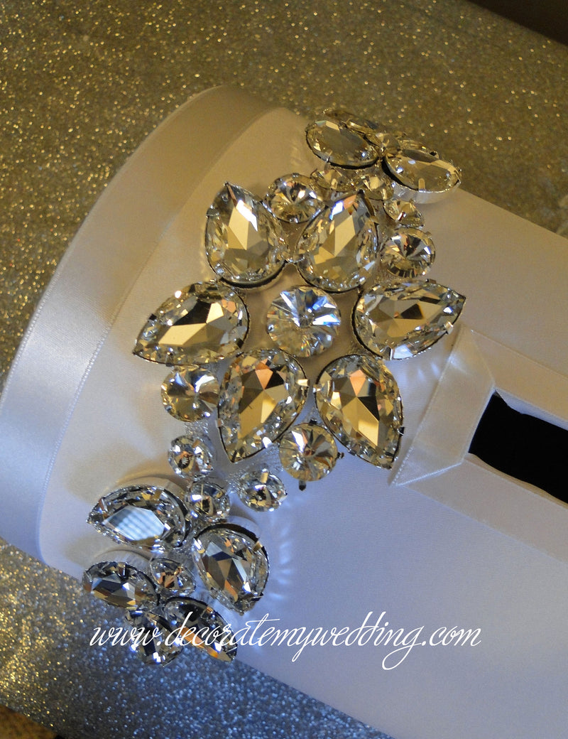 Card box is trimmed with large clear rhinestones in a floral shape.