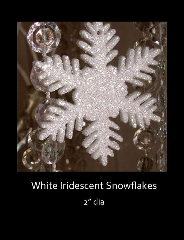 "These iridescent white snowflakes are completely covered with an iridescent finish and measure 2"" in diameter."