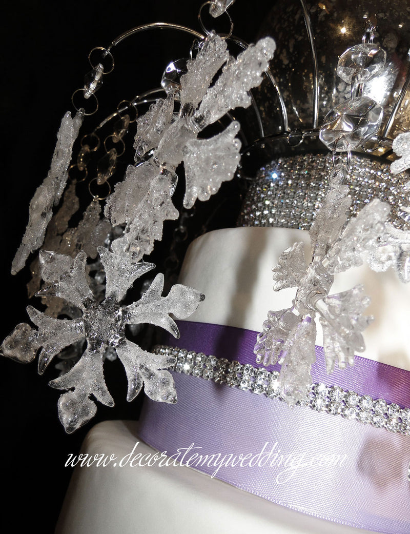 A variety of different snowflake designs are used to make this cake topper.