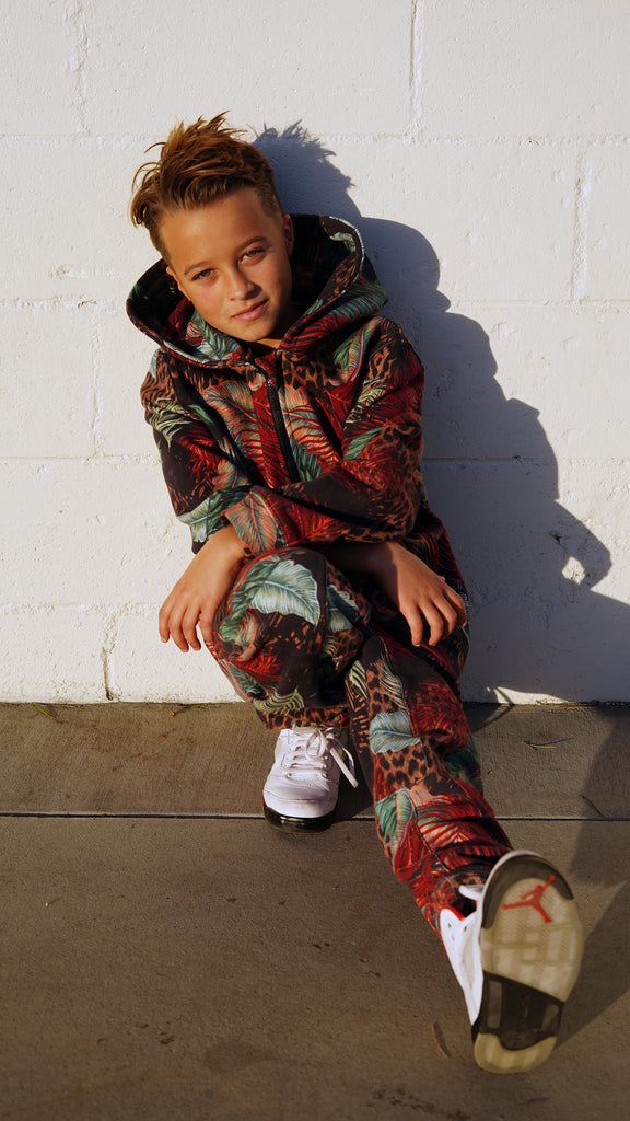 Boy in red leaf leopard print hoodie and jogger