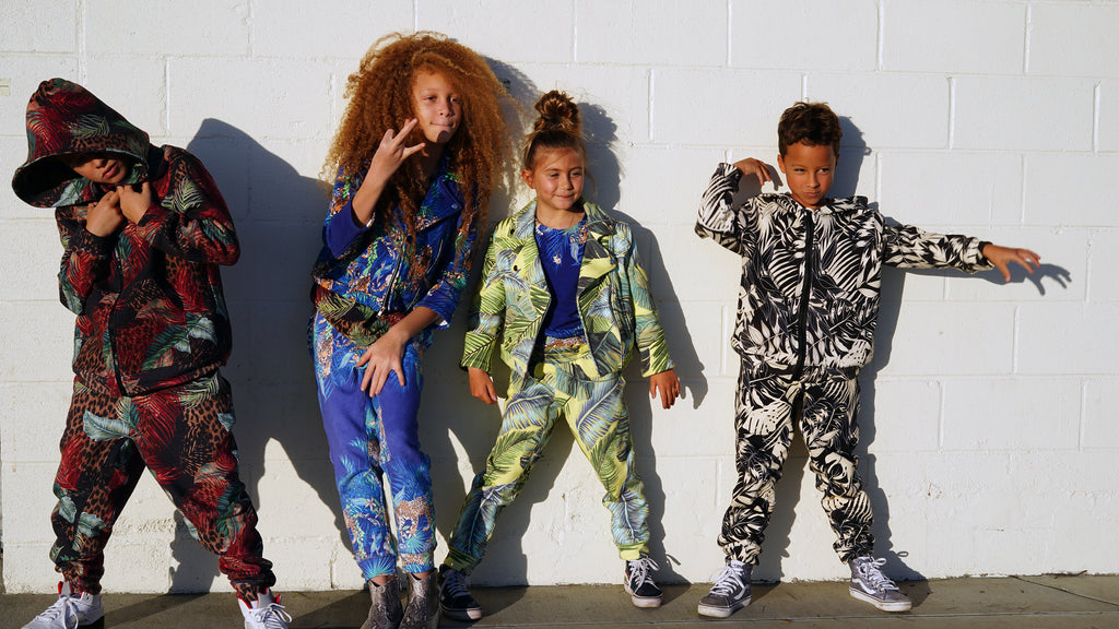 group of four kids wearing items from the new JungleGurl Keiki collection