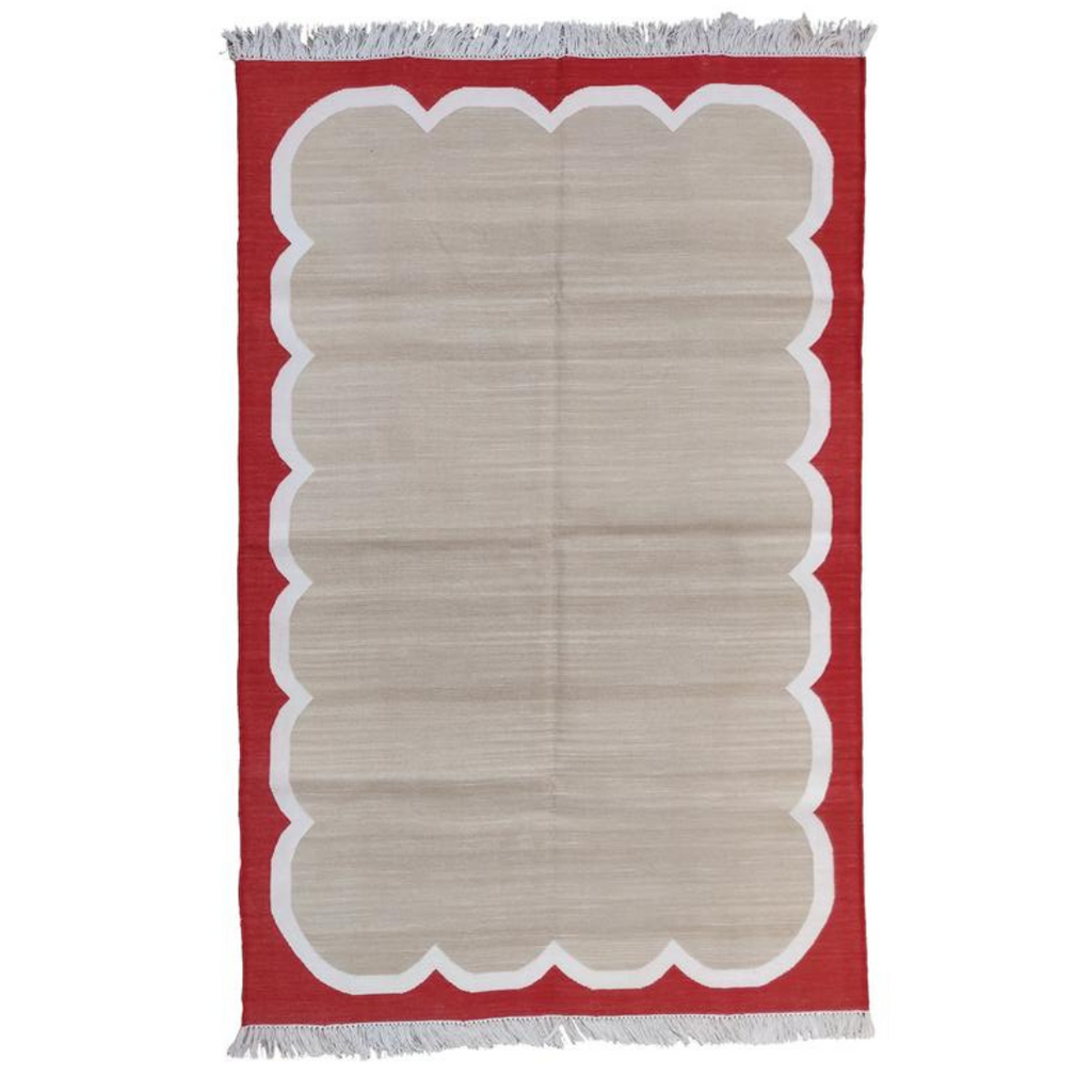 Scalloped red flat weave rug