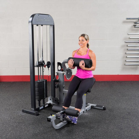 Image of Body-Solid Pro Select GCAB-STK Ab And Back Selectorized Female Sitting