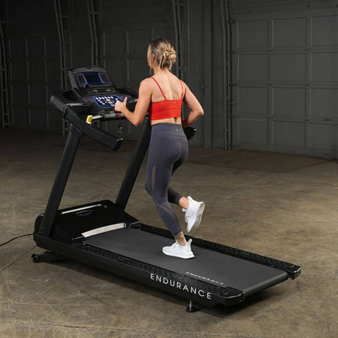 Body-Solid T150 Commercial Treadmill Back Side View Female Model