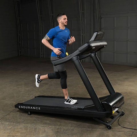 Body-Solid T150 Commercial Treadmill Side View Male Model