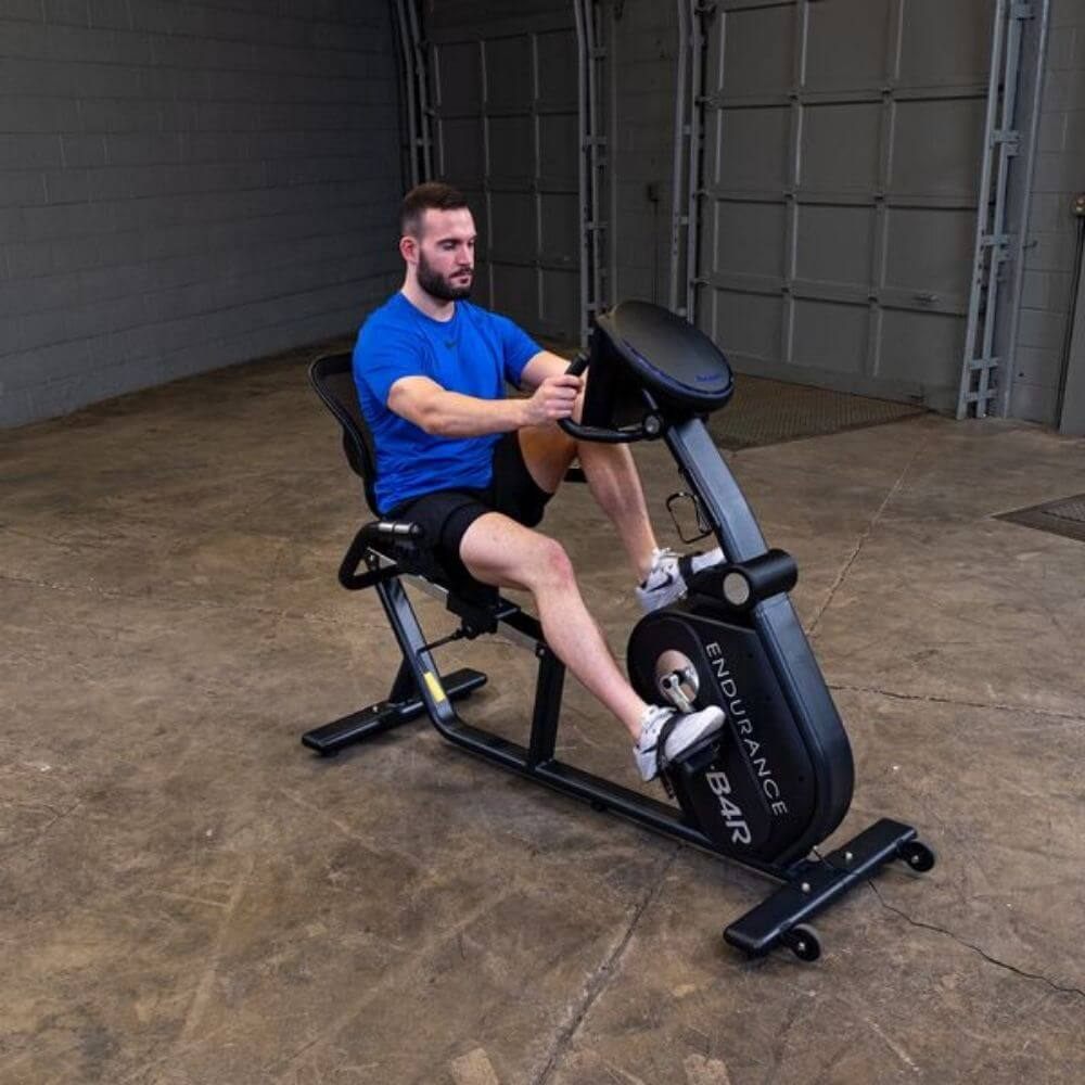 Endurance by Body-Solid Recumbent Bike B4RB Front Side View Male Model