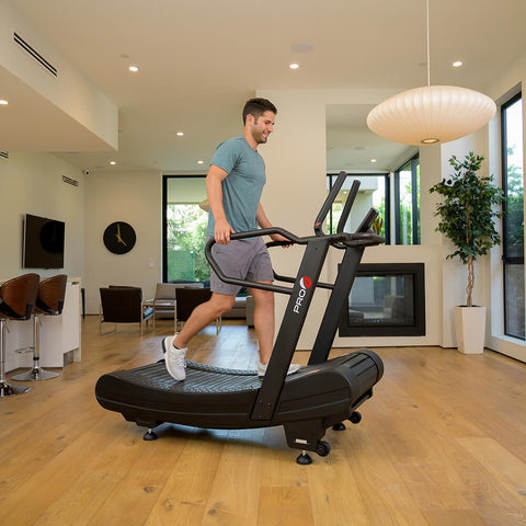 Pro 6 Arcadia Air Runner Treadmill Male Model Side View Holding