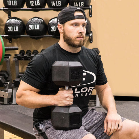 Image of Valor Fitness Rubber Hex Dumbbells RH One Hand Sitting