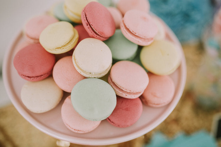 A heap of multicolor macarons on cake stand