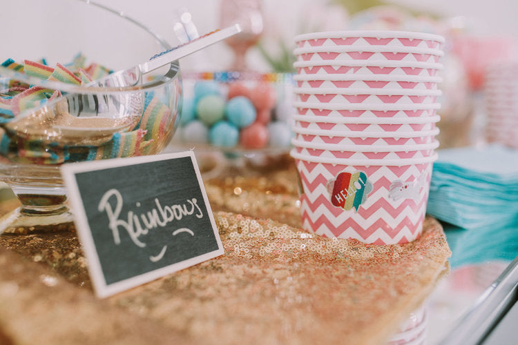 Closeups of candy jars and empty paper bowls