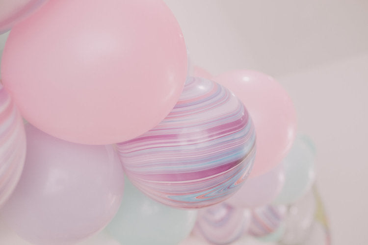 Closeup of solid and marbled pastel latex balloons