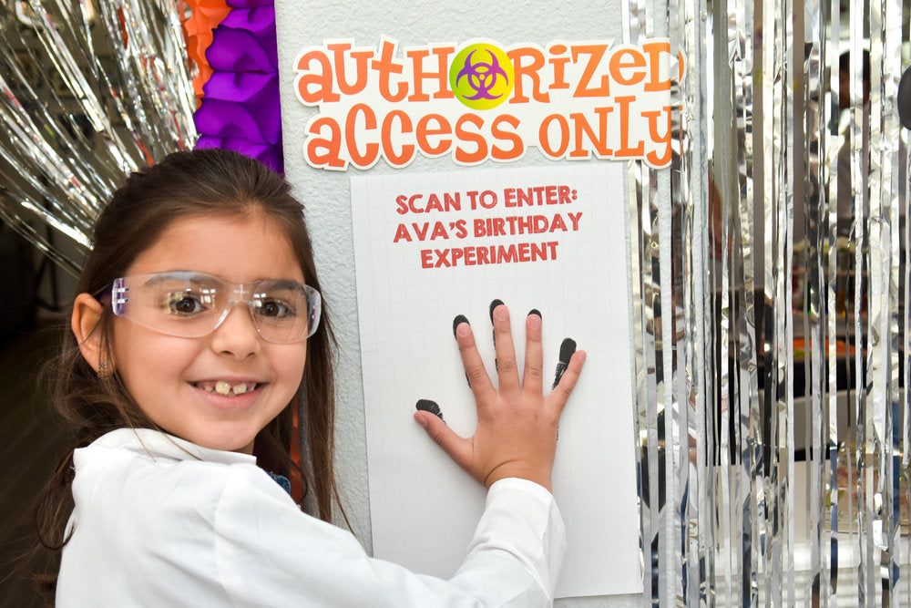 "Birthday girl scanning her hand on ""Authorized Access Only"" sign"