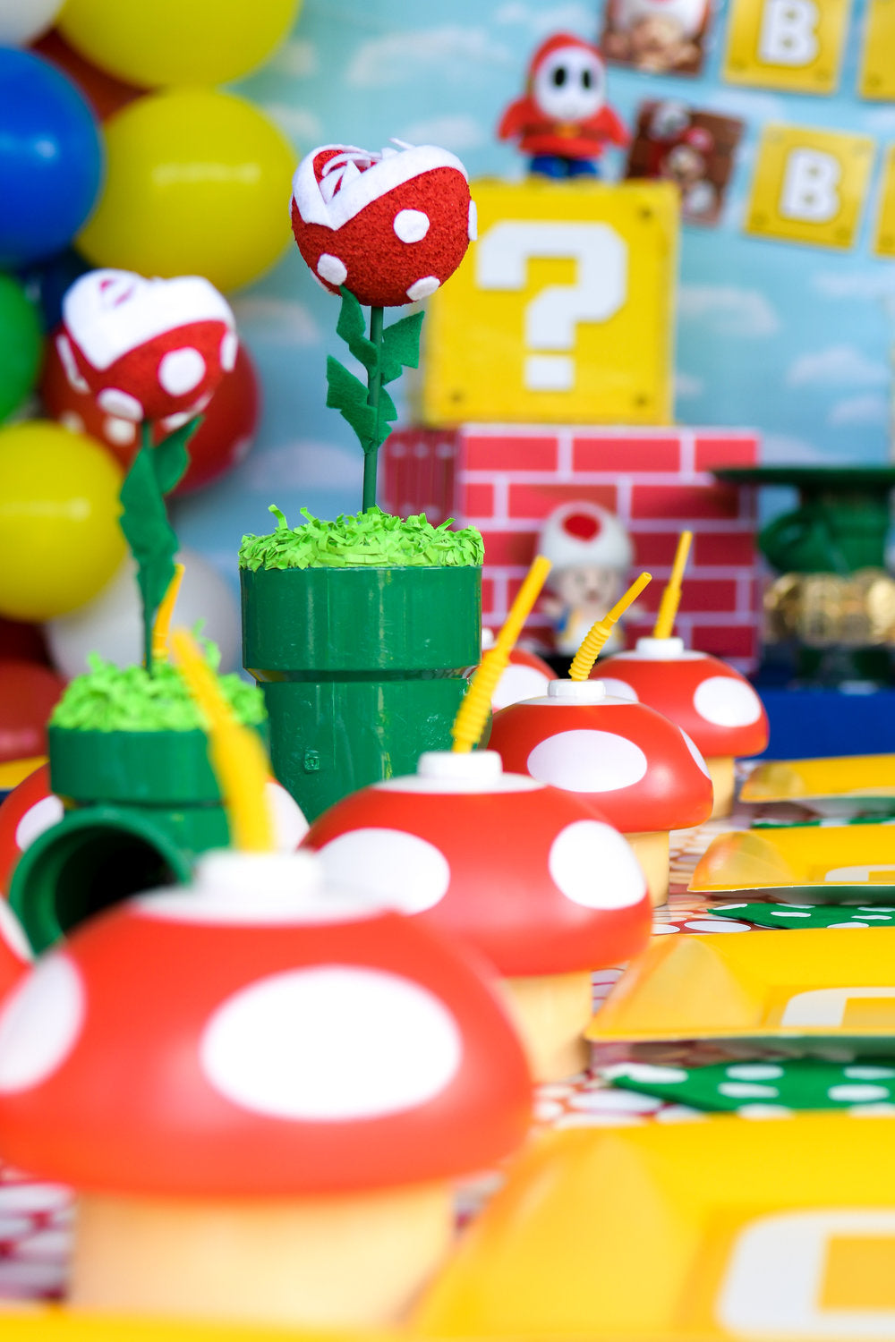 Closeup photo of Super Mario Bros themed centerpieces with mushroom drinking cups