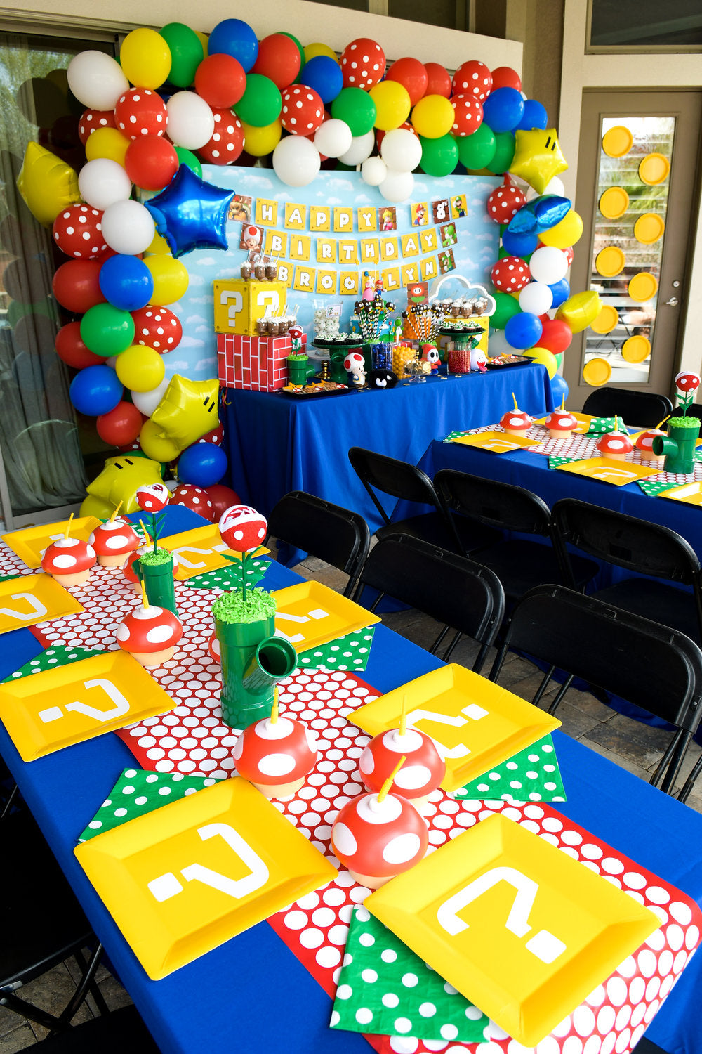 Super Mario Bros decorated party space with decorated tables